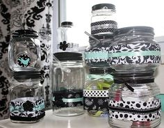 Decorative Jars for Embellishments - Scrapbook.com - So cute! Decorated jars using ribbons, flowers and paper punch to store scrapbooking embellishments. Great ideas!! #scrapbooking #crafting #storage