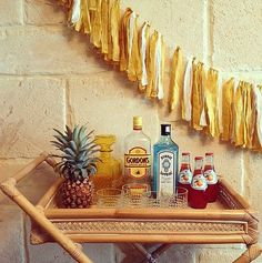 Tropical Touch Since bar carts are essential for entertaining, style them to your party's theme. Even before the drinks are served, this tropical setup establishes a laid-back vibe that is sure to kick-start any party. Source: Instagram user bowerhouse