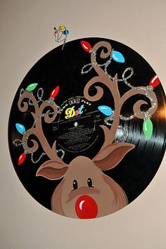 Cute idea for if you found the actual vinyl and it was too scratched or in too rough of shape to actually play! Would be cute to do kids 45's using Christmas records. Handpainted Rudolph Vinyl Christmas Music by CamaleeKateStudio, $27.00