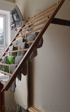 Old Baby Crib Side Rails...re-purposed into a wall mounted clothes drying rack!!  Genius!  Instructions included on this site.