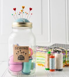 Keep your sewing threads and needles organized in a mason jar.
