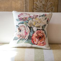 Octavia Blossom Digital Floral Cushion  a rich and vivacious digitally printed floral cushion. feminine impressionistic arrangements in warm summer shades, upon a soft white linen ground. fine apple silk trim on all sides, and neutral reverse. | Designers Guild UK