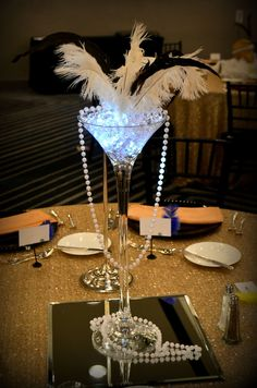 Great Gatsby Centerpiece http://www.idealpartydecorators.com