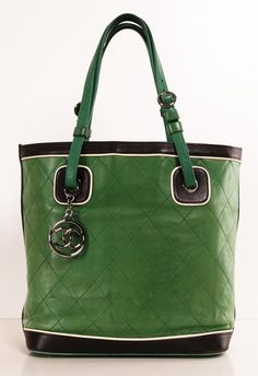 Chanel Quilted Green Tote. I kinda really want this. I'm not a huge purse person... but I likey A LOT!