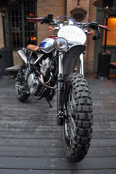 "Honda NX650 ""custom scrambler"" by Kiddo Motors.   Giancarlo Rauso, the builder of this special Honda NX has suggested some modifications to the original Kiddo idea:  an high Arrow scrambler exhaust, and a custom paint for the fuel tank  (Ottocento11 means Eight Hundred11)  The particular position of the headlight allows to mount a cool vintage cross style number plate to add a retro/racing touch."