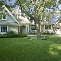 Single-Story Home Design: Front View (traditional exterior by John Kraemer & Sons)
