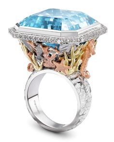 The Theo Fennell Under the Sea ring features finely detailed fish, seahorses and coral around a 44.87ct Blue Topaz. The Topaz is incredible clear and beautifully mimics the depth of the sea. From The Jewellery Editor