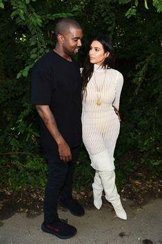 Kanye West and Kim Kardashian attend the Kanye West Yeezy Season 4 fashion show.