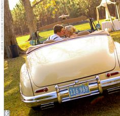The couple drove off in the vintage Buick convertible Wyley bought a few months before the wedding. This photo was actually shot before the reception; the groomsmen later decorated the car with toilet paper and shaving cream.