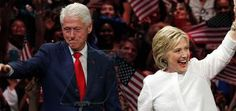 Former President Bill Clinton stands onstage with his wife, Democratic presidential candidate Hillary Clinton. (Julio Cortez/AP)