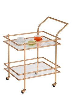 Loving this polished goldtone bar cart for a modern-chic look in the home.