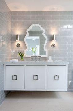 Gray tiled bathroom. Elevated vanity