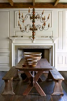 This classic #diningroom needs little decor with that beautiful #mantel and #chandelier