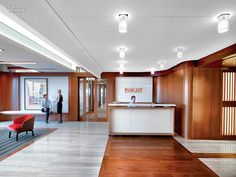 Midtown Architecture Inspires SmithMaran for Insight Venture Partners HQ Office. Oak reclaimed from barns alternates with marble and travertine for flooring in reception.