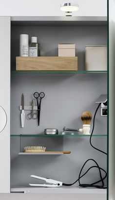 Stylish external LED light in combination with mirror cabinet with built-in shaver points. Lots of storrage, metal shelf and magnet strip.