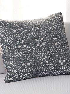"""Linen House at Simons Maison.  A sophisticated design in the bedroom with this traditional moroccan tile motifs on a weft featuring intertwined topstitch circles for a beautiful, quilted texture.  Matching duvet cover also available.  Euro size 26"""" x 26"""""""