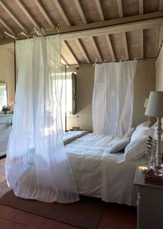 Another Italian Farmhouse - love the ceiling. Also love the idea of doing something design-wise like this with the guest bed. A faux canopy kind of thing.