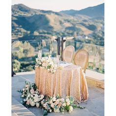 Stunningly beautiful bride and groom table with a view. Photo: @constancelyu | Cinematography: @fondproductions | Event Planning: @cclweddings | Floral Design: @peonyandplum | Venue: @maliburockyoaks | Linens: @latavolalinen | Rentals: @tacer_losangele