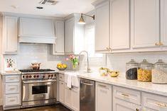 Ashley Goforth Design Grey kitchen, Brass hardware, Wolf range, circa library lights, marble counters