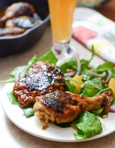 Beer Glazed Citrus Chicken with Orange Arugula Greens I howsweeteats.com