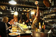 Pintxos aka tapas bar in San Sebastian . They are famous for these food and wine bars.