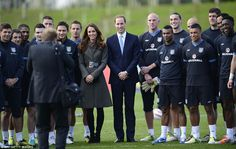 The Duke and Duchess of Cambridge pose along with members of the England football team during the opening of Football Association's St George's Park in Burton-Upon-Trent today