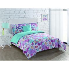 Perfect for any girl's room, this Butterfly Winds Comforter set will look beautiful on any bed. This reversible comforter set has two patterns that will dress up any room.
