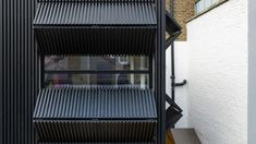 Completed in 2018 in Islington, United Kingdom. Images by Peter Landers. Black Box is a small first floor rear extension to a mid-terrace Victorian-era house in Islington. Our client, a couple, wanted a space that could. Brick Extension, Rear Extension, Large Windows, Wooden Shutters, Victorian Terrace, Victorian Era, Recycled Brick, London House, Flats