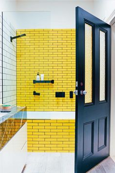 This statement yellow subway tile shower will brighten up your bathroom in ways you never knew were possible.