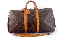 Louis Vuitton Keepall 50 With Strap And Luggage Tags Brown Travel Bag.