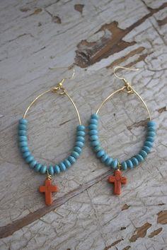 A simple orange cross hangs amongst a sea of turquoise beads on a gold wire. Earrings measure 4 inches in length and are a hook style earring. Made by Knot & Bow. All earring sales are final. Cross Earrings, Diy Earrings, Turquoise Beads, Turquoise Bracelet, A Hook, Gold Wire, Knots, To My Daughter, Orange