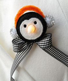 Penguin Flameless Tealight Pin designed by EmbroideryGarden.com