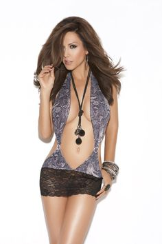 Snakeskin print stretch mini dress with rhinestone applique and lace skirt.