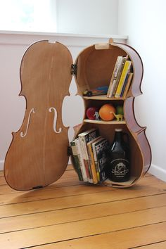 Last fall I received a broken cello from a grade school music teacher and was asked if I could build it into anything neat. This is what I came up with.