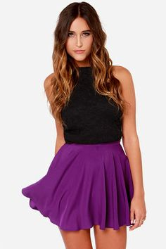 "You've got a style sense that can't be beat, and thanks to the For Sienna Pure Talent Purple Flared Mini Skirt, you can show it off in a whole new way! This purple skirt starts with a fitted waist for an incredible fit, with soft woven poly fabric that flares out towards the bottom hem. This skirt is sure to be a stylish accent piece to any top you want to pair it with. Hidden side zipper. Unlined. Model is 5'8"" and wearing a size small. 100% Polyester. Machine Wash Cold. Made with Love in…"