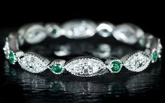 Emerald wedding band…Perhaps an accent to your emerald engagement ring or even to hold its own next to a diamond ring!