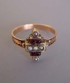 "VICTORIAN 10k yellow gold garnet and seed pearl ring, size 6, 1/2"" at front, circa 1880."