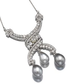 ATTRACTIVE NATURAL PEARL AND DIAMOND PENDANT, CARTIER, CIRCA 1910. The articulated pendant supporting three natural pearls of grey tint, set throughout with rose, single- and circular-cut diamonds, highlighted with a further pearl, to a fine link chain, length approximately 385mm, signed Cartier London, accompanied by case signed Cartier London.