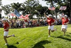 Team USA's Paula Creamer, left to right, Christina Kim and Morgan Pressel run on the 18th hole after their singles match at the Solheim Cup golf tournament Sunday, Aug. 23, 2009, at Rich Harvest Farms in Sugar Grove, Ill. The USA team won 16-12 to retain the cup. (AP Photo/Michael Conroy) Photo: Michael Conroy, AP #SC13