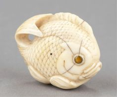 An ivory netsuke of a sea bream