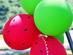 Watermelon Balloons - picnic party - So simple to do, yet visually stunning. Dot your red balloons with a black sharpie and then pair them with bright green ones for a watermelon themed picnic.
