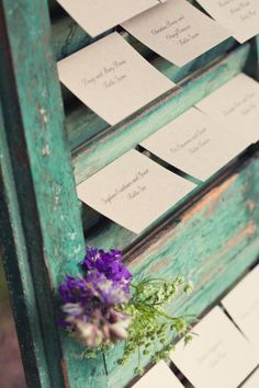 Rustic Shutters hold Escort Cards | Tara Welch Photography