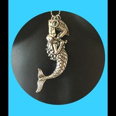 Necklace silver mermaid with charms 24 inches NEW Silver mermaid with 24 inch chain,charm of Blessed,charm of made with love and abalone she'll. Beautiful silver pewter Jewelry Necklaces
