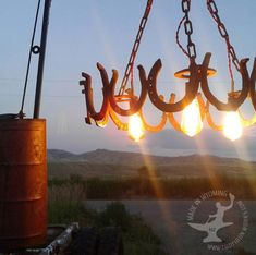 Hand forged home decor by Wyoming Blacksmith NJ Pawley by CodyIronWorks Horseshoe Crafts, Horseshoe Art, Guest Ranch, Horse Stables, Western Homes, How To Make Shoes, Hanging Lights, Blacksmithing, Horse Shoes