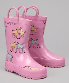 A little rain can't stop these boots from walking. Heavy-duty rubber and a traction sole make splashing through puddles a dry activity. Kids will appreciate the handy tabs and soft cotton lining that make this printed pair a joy to wear. Rubber upperTraction soleImported