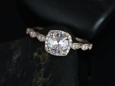 This engagement ring is designed for those who love simple with a slight twist. The round cut in the center is traditional while the cushion halo gives it a little twist!  All stones used are only pre