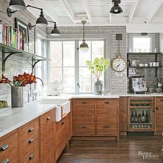Black Sonces Over Open Shelving In Grey And Wood Kitchen