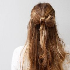 Add a cute and romantic touch with this holiday-ready hair bow. #halfup #hairstyles #bow