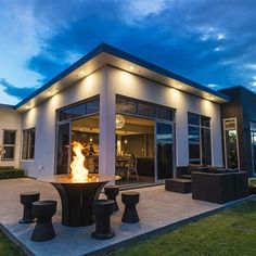 A stylish fireplace, such as the EP1350 Outdoor Fire Table from Escea, can help make your patio enjoyable for entertaining year-round. Protect your exterior con... Outdoor Fire Table, Outdoor Living, Outdoor Decor, Timber Cladding, Exterior Cladding, Concrete Pavers, Stained Concrete, Backyard, Glass