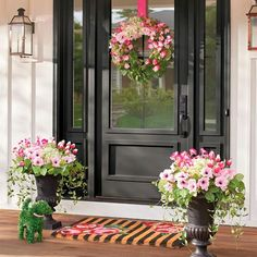 front porch ideas curb appeal Everything's coming up pink, and so pretty. Our Blooming Blossom Greenery is bursting with spring's best, from delicate poppies and hydrange Front Door Porch, Front Door Entrance, Front Entrances, Front Door Decor, Entry Doors, Glass Front Door, Front Porch Lights, Front Porch Decorations, Front Porch Flowers